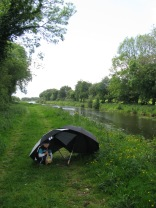 Our two brolly tent... well needed and appreciated... such planning ;-) GSK clutching the bag of bread...