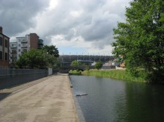 ... wide canal and walkway lead to the Summerhill Parade Bridge and on to the stadium...