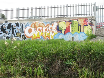 ...decoration on the bland concrete wall at the car park...