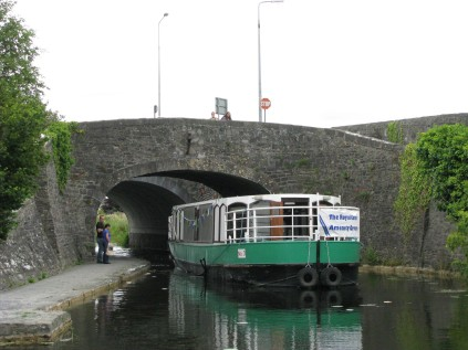 Mother and son and others watch MK steer into Maynooth Harbour