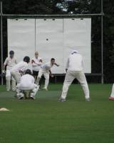 The fielders all wait to pounce! The catch came moments later... giving the lad his 2nd wicket!