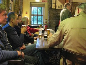 The Rambler crew all appreciate their pints while Stephen Rooke finilises the plans for the next shot... again thrught the fuzzy window...