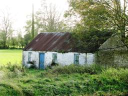 This old cottage must have still been in use not too long ago... note the electricity pole to the left of the building... the wires were still intact... This old cottage must have still been in use not too long ago...