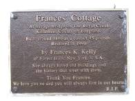 The plaque on the cottage wall tells of dedication...