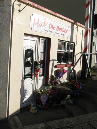 Mick's door - Floral tributes at the door of Mick's shop...