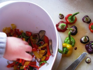GSK helps oupa with the peppers... remember the peppers? Yep, from our own plants...