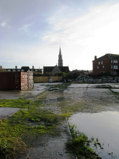 Ground behind fences... St Patrick's Church in Ringsend in the distance...