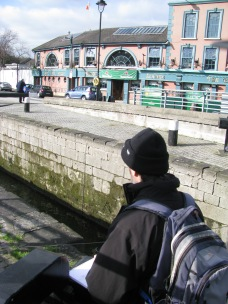 Peeping of the the artist's shoulder... the Barge Pub, rather popular, in the background