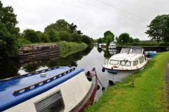 There's a fork in the road... nah, the old Barrow Line moves off to the left, the Grand to the right. Boats moored east of Lock 19.