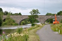The three arch Bord na Mona light rail bridge... see another runner...