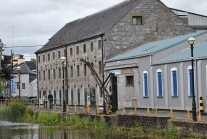 The bonded warehouse of the Tullamore Dew brand... I wonder? Note the old crane in front of the building...