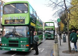 Green busses at the ready - Hop on Hop off... take a ride around the sights... if you please!