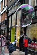 Young bubble popper on Grafton Street gets his timing right, Dublin Ireland