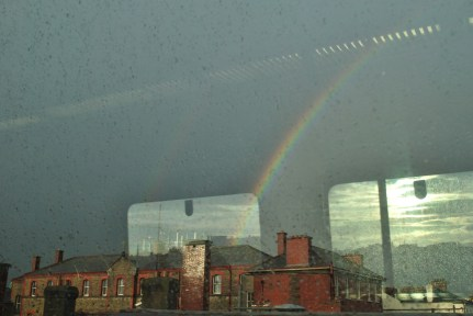 Rainbow across Dublin, from the train window... reflections