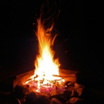 The warm glow of the campfire... stirs the memories...