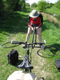 Real shadows... the cyclist repairs a puncture...