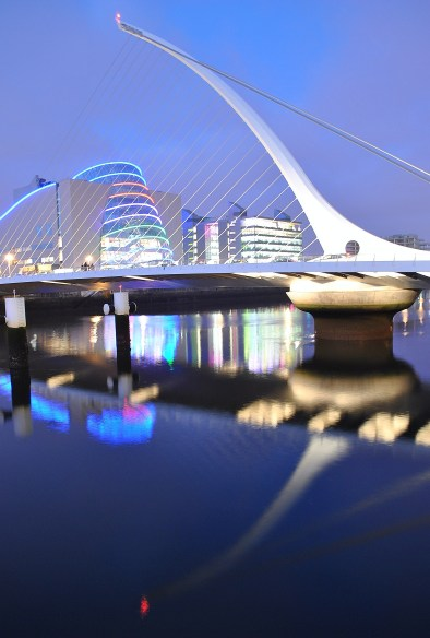 Liffey reflections, the multi coloured display of the Convention Center as seen through the stays of the Samuel Beckett Bridge, Dublin, Ireland