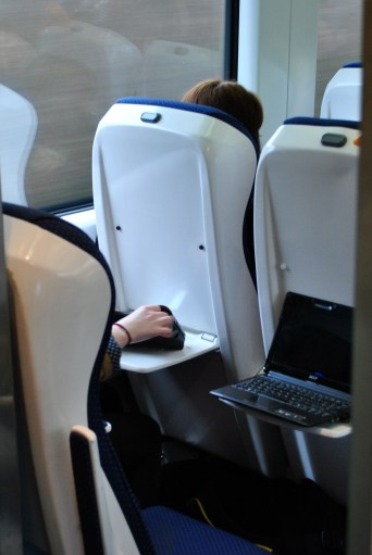 Hand and notepad... train thrills?