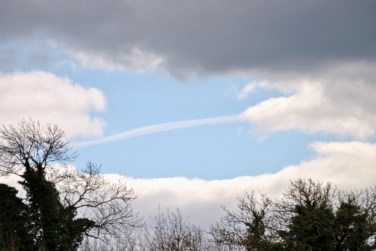 Vapour trail stripe through the hole in the sky!