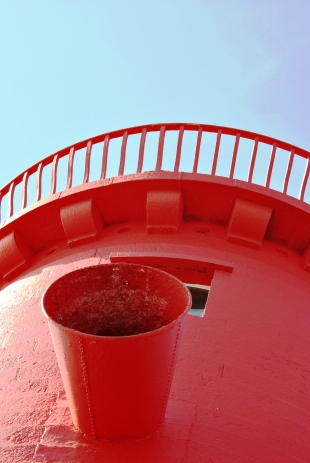 Bright red against pale blue sky...