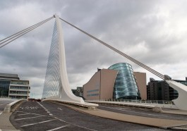 Looking through the strings of the harp... the view of the Dublin Convention Center between the Samuel Beckett Bridge stays...