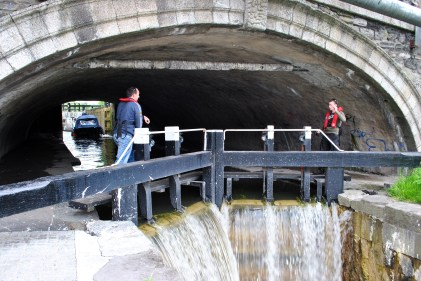 The 2nd Lock is jammed in beneath the bridge... a tight fit for larger boats. The friendly, helpful lads from WI manning the lock gates...