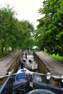 Boats moving into the higher chamber of the 2nd Lock. The lock keepers were doing the double locking stunt... note the cascade over the upper sill...
