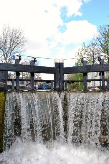 Water cascading over the lock gate at the first Lock on the Royal Canal, Ireland. As seen from the deck of JT's 4E.