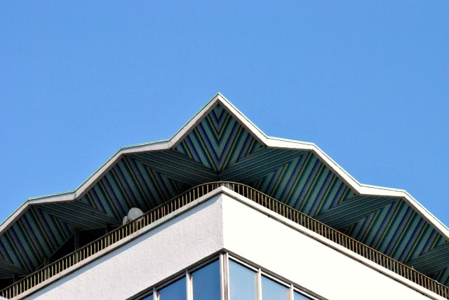 The horrid Liberty Hall in Dublin has the odd redeeming feature... the tilted roof detail against a blue summer sky... points of interest?