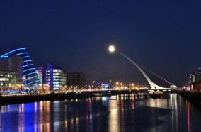Feb 25 2013 - Full moon rising! The tip of the Samuel Beckett Bridge in Dublin acts as fingertip! Surely one of the best (luckiest) photos I've ever taken!
