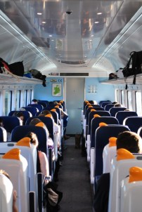 Neat lines of train seats...