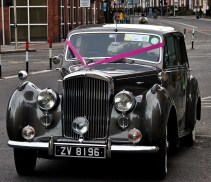 Grand old lady dressed for the occasion..ey... regal Bentley on a Dublin street...