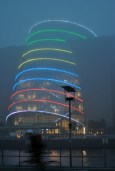 Misty evening in Dublin... a cyclist flashes by the Convention Center