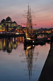 Dublin sunset along Custom House Quay, the replica of the Jeanie Johnson famine ship against the sunset backdrop...