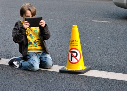 Sheltering behind the traffic cone, Pearse Street, Dublin, Ireland... during the 2013 Dublin Marathon...
