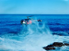 Alo 111 620 hovers over rocks at Cape Recife, photo taken 29 May, 1990