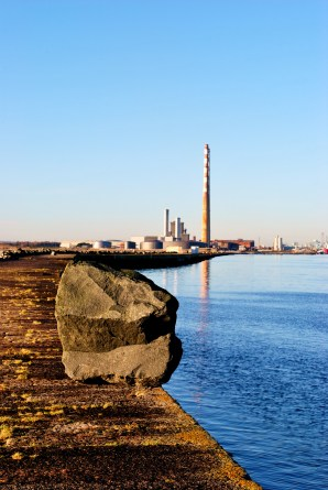 Rocks on the Great South Wall, Dublin Ireland. Storm debris with a difference! Looking towards the city and the Poolbeg Chimneys...