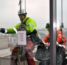 Fixing the windows... dangling from a rope on the 9th floor...