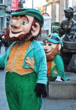 Leprechauns aplenty... hard work in front of the Statue of Molly Malone, Dublin, Ireland