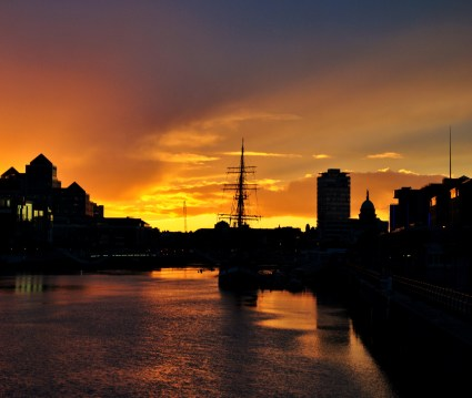 Liffey sunset. The Famine replica ship the Jeanie Johnston on Custom House Quay, Dublin, Ireland