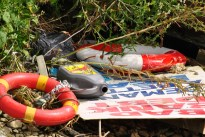 Aren't those life bouys needed by someone? Abandoned in the rubbish...
