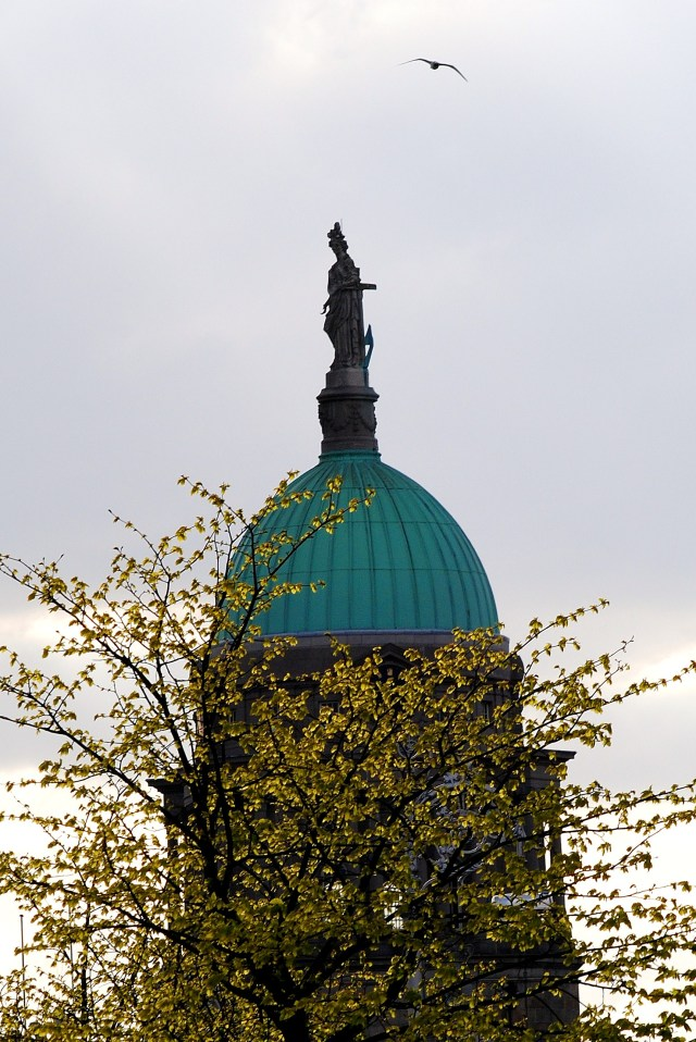 The green dome of Custom House... who's the lady atop the structure?