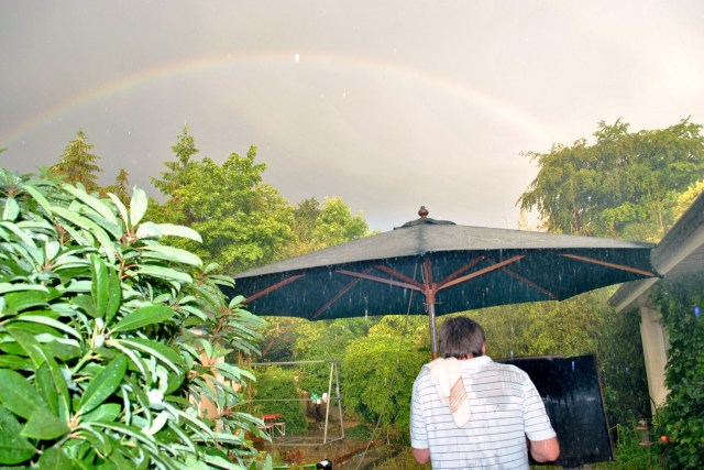 How's that for a twist? Lashing rain against the backdrop of a rainbow!