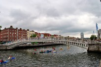 High summer... Dublin's Haypenny Bridge - canoes decorate the waters of the Liffey