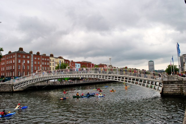 Hi summer... Dublin's Haypenny Bridge - canoes decorate the waters of the Liffey