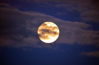 10 Aug 2014, super moon playing hide and seek with the clouds...