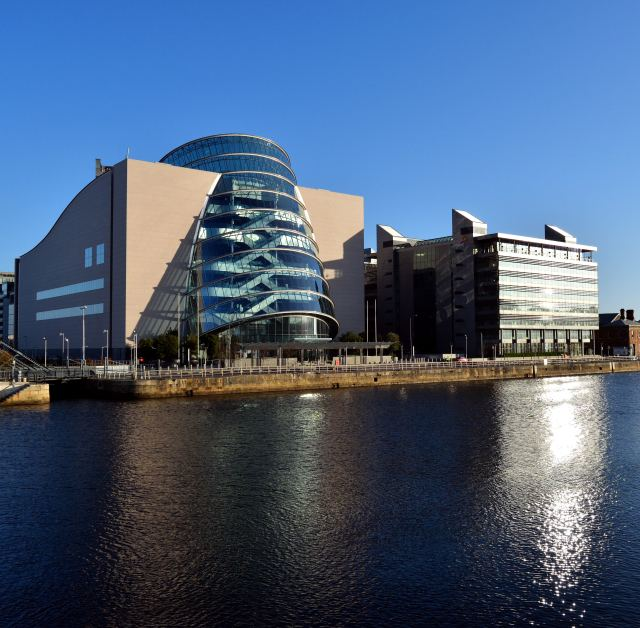 The sun shines and reflects of the Dublin's Convention Center and the PWC building