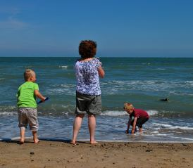 On the beach... granny and lads... soon their sister will join in the fun!