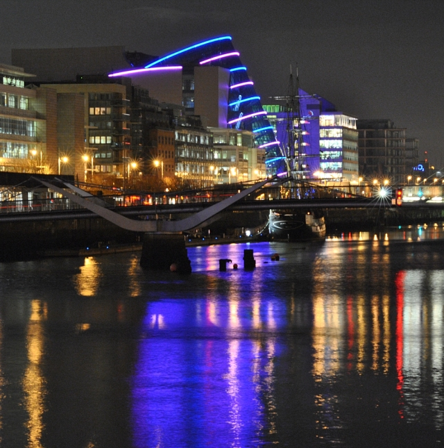 The Dublin Convention Center throws it's own glow... under a January full moon!