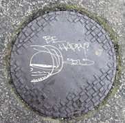 Be Happy!! Manhole cover seen on Dublin's Kildare Street!